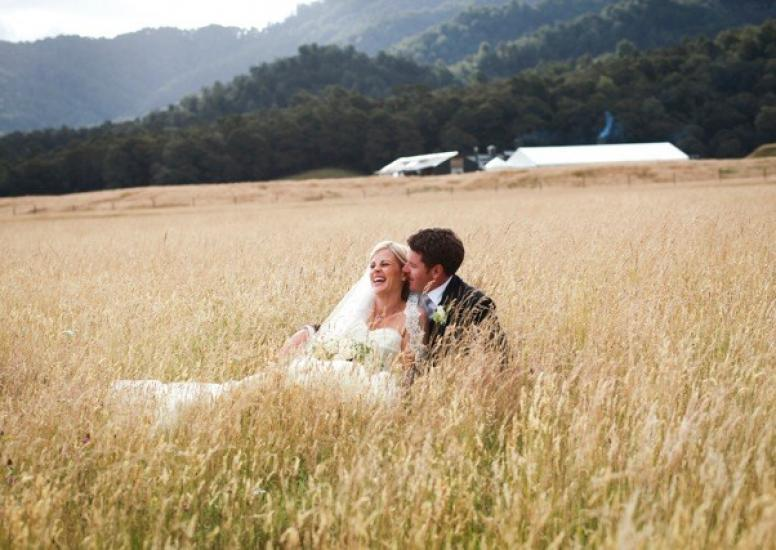 Adam and Anna in long grass at Stables3
